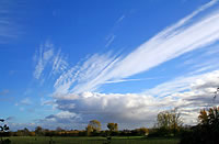 Margaret Nelson's photo of cirrus and cumulus clouds in a cross wind
