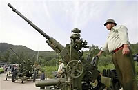 Chinese gun crews ready to blast clouds