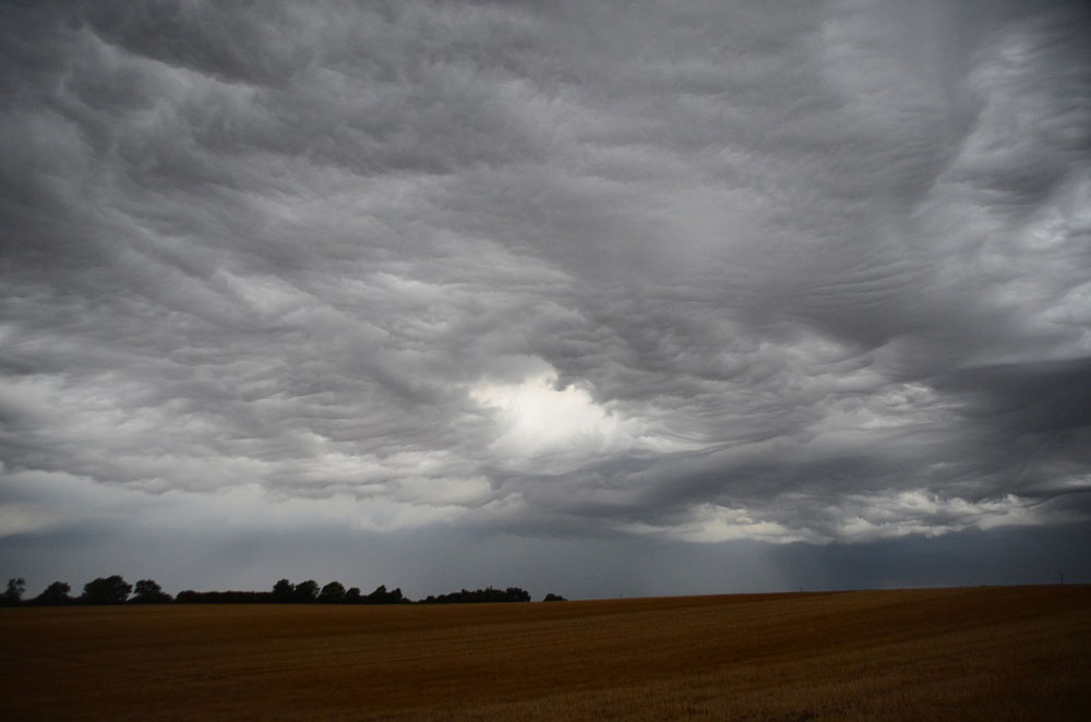An asperitas formation over Little Gidding, Cambridgeshire, UK by Jenny Mortimore