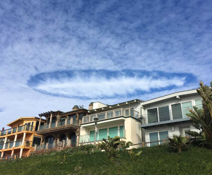 A fallstreak hole over Manhattan Beach, Los Angeles, California, US.