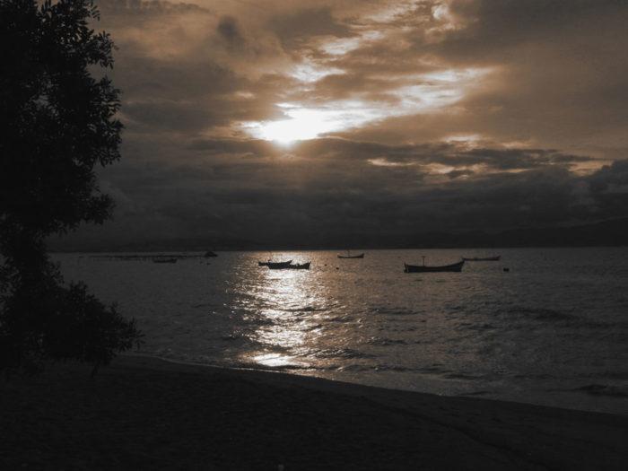 A sunset over Cacupe beach, Florianopolis, Brazil.