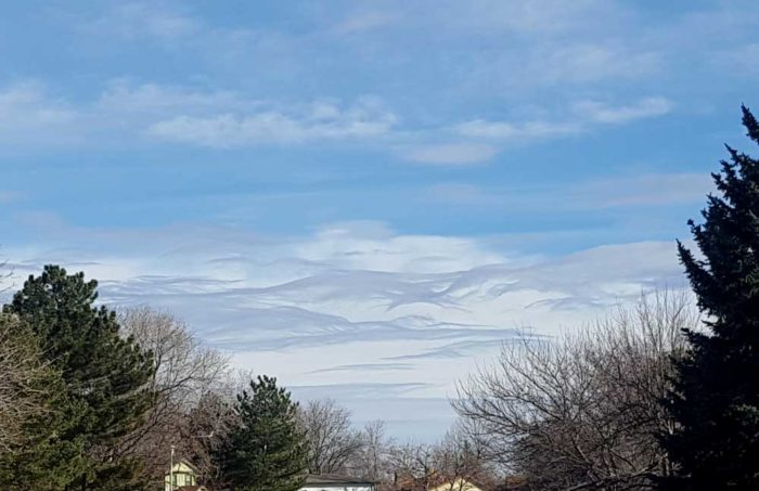 A dissapating asperitas formation over mountain-like Cumulus, Arvada, Colorado, US.