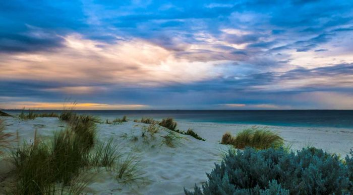 A sunset over City Beach, Perth, with a hint of asperitas that mirrors the ripples in the dunes below.