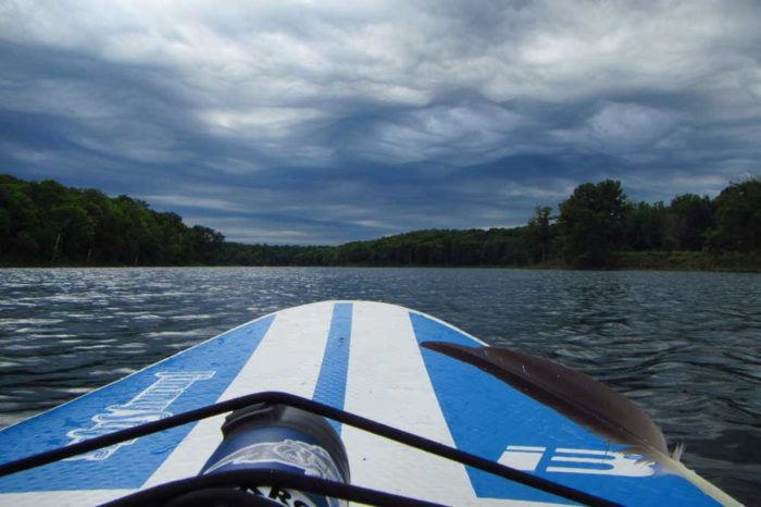 An asperitas formation viewed from a paddleboard on Hook Lake, Minnesota, US.