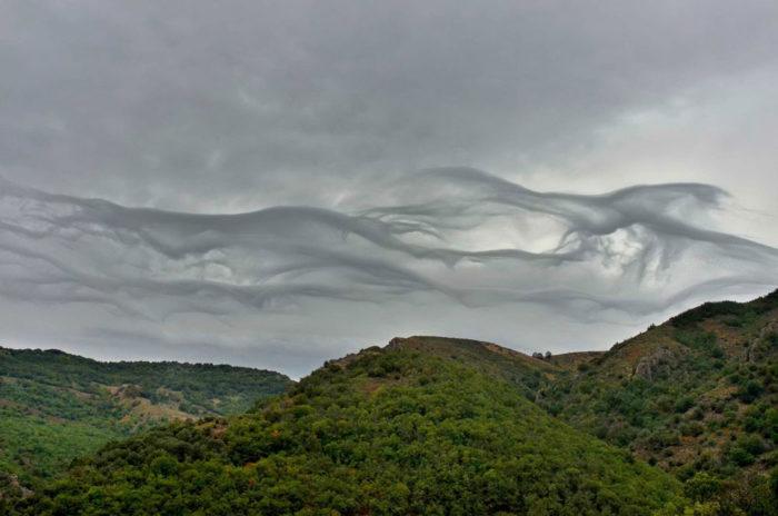 A dissipating asperitas formation over Barre-des-Cevennes, Lozere, France.