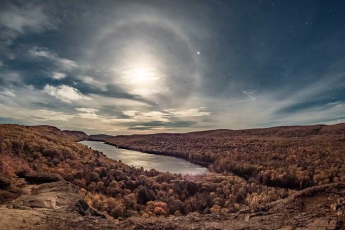 A lunar halo over the Lake of the Clouds, Porcupine Mountains, Michigan, US.