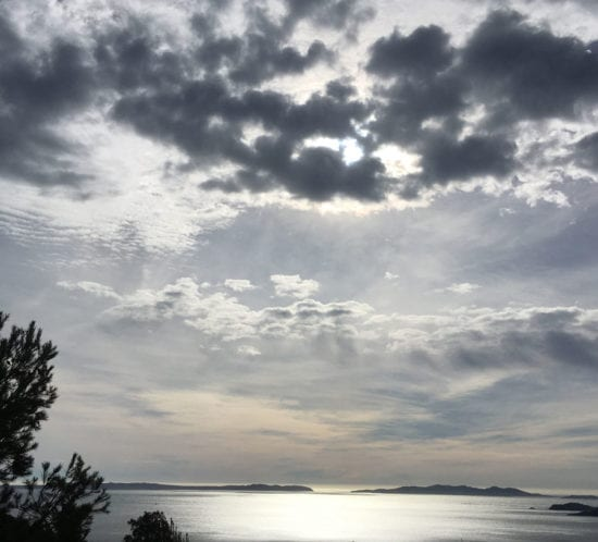 A cloud mix over the village of Lavandou with a view of the Isles d'or, France.